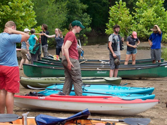 Visitors and residents of the Jones Center launch canoes