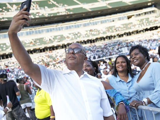Tracy Perkins of Chicago takes a selfie with friends,