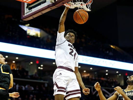 Missouri State Bears forward Alize Johnson (24) dunks