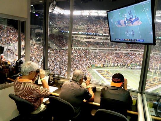 Bengals announcer Tom Kinder, Jr., left, his brother,