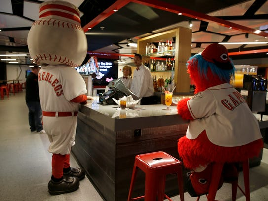 Reds mascots Mr.Redlegs, left, and Gapper hang out