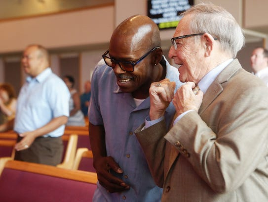 Marvis Ware, 59, greets pastor emeritus Clyde Miller before the 9:30 Sunday morning service May 27, 2018, at the Peoples Church in the Cincinnati neighborhood of Corryville.
