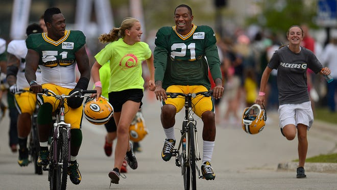 Packers safety Ha Ha Clinton-Dix rides a youngster's bike to training camp practice at Ray Nitschke Field on Aug. 7, 2015.