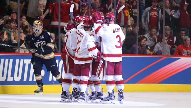 Denver Pioneers forward Dylan Gambrell (7) celebrates a goal during the second period against the Notre Dame Fighting Irish at United Center.