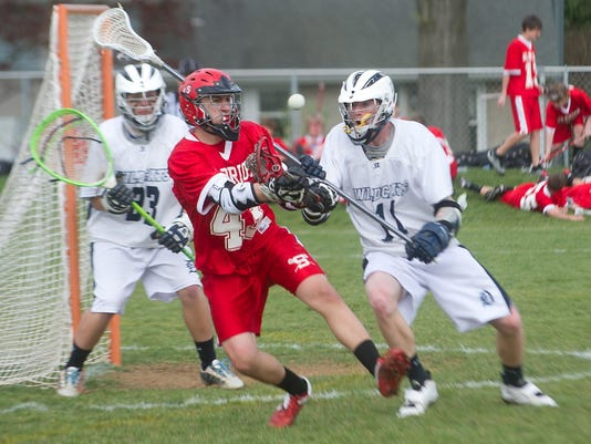 Zach Gloeckner on the left in red. Photo by Paul Kuehnel/York Daily Record