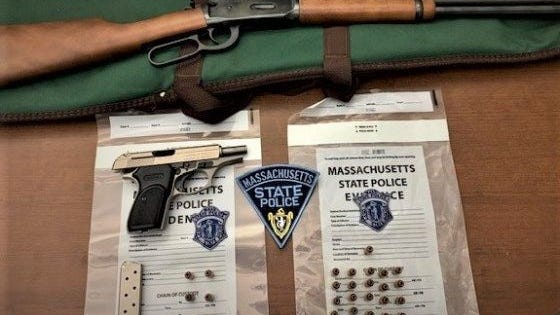 Massachusetts State Police arrested three men after finding these guns in their minivan after a traffic stop Wednesday in Weston.