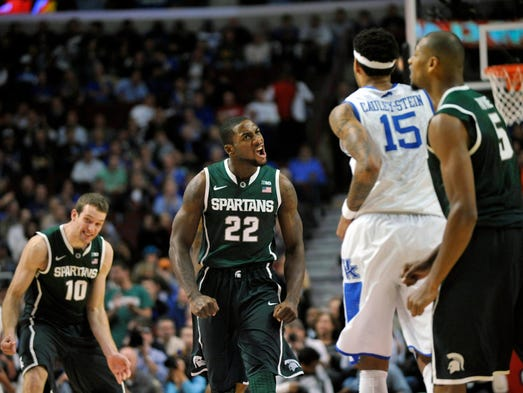 Michigan State Spartans guard Branden Dawson (22) reacts after a first-half basket against the Kentucky Wildcats.