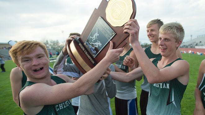 The Heritage Christian boys team celebrate a 1A state title during the CHSAA State Track and Field Championships at JeffCo Stadium in Lakewood on Sunday, May 21, 2017.