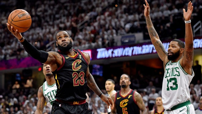 Cleveland Cavaliers forward LeBron James (23) shoots the ball against Boston Celtics forward Marcus Morris (13) during the first quarter in game six of the Eastern conference finals of the 2018 NBA Playoffs at Quicken Loans Arena.