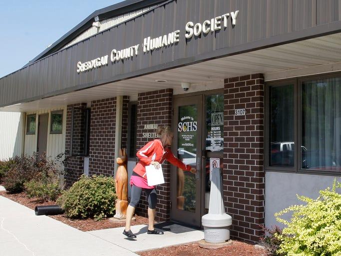A woman walks into the Sheboygan County Humane Society Friday August 15, 2014 in Sheboygan.