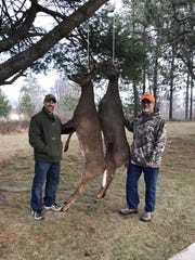 Tom Romoser (right) of West Bend and his son Aaron Walz of Janesville pose with a buck and a doe the pair shot while hunting in Marinette County.