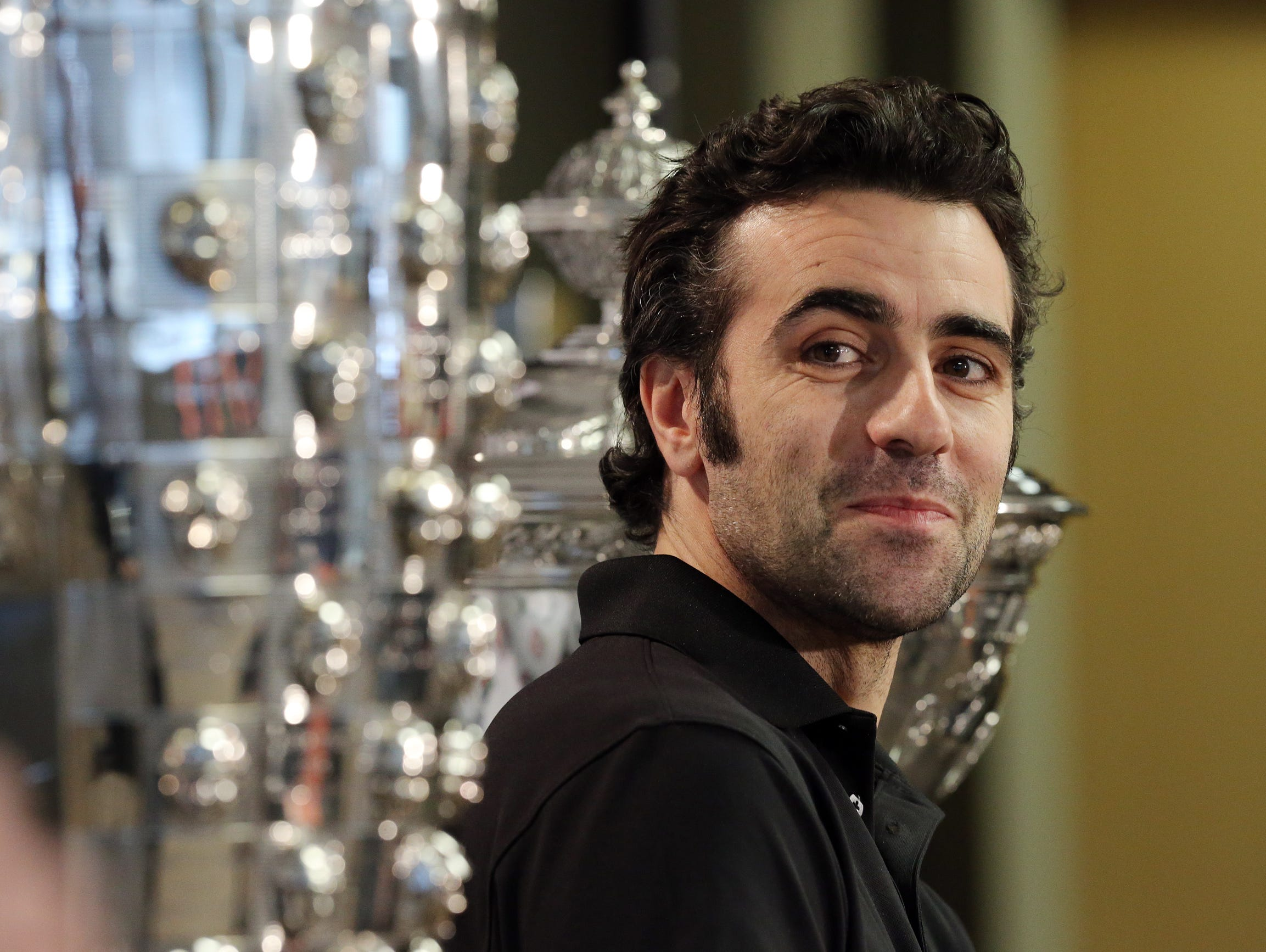 FILE -- Dario Franchitti talks about his decision to retire from racing during a news conference at Target Chip Ganassi Racing headquarters, Dec. 19, 2013.