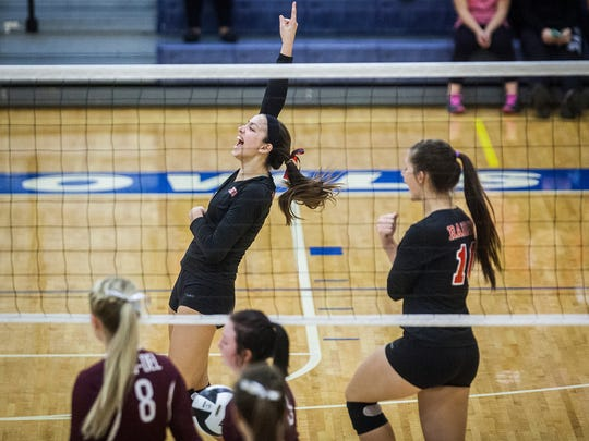 Wapahani celebrates a point against Wes-Del during their sectional game at Ball Gymnasium Wednesday, Oct. 21, 2015.