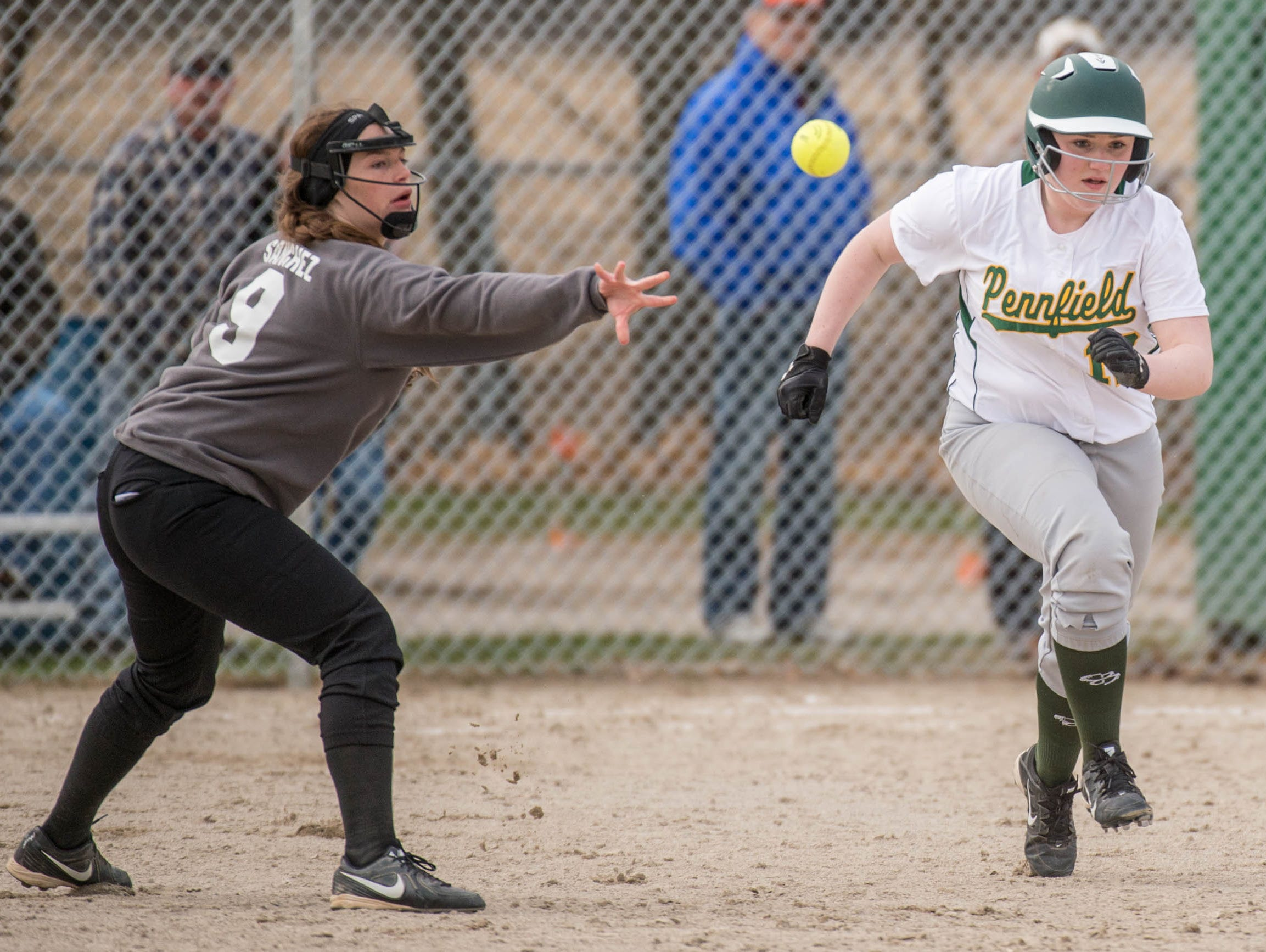 Pennfield's Kaylee Clothier (12) attempts to out run Lakeview's Shelby Sanchez throw to second during a recent game.