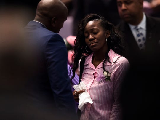 JaQui'ta Robinson walks to her seat after viewing her deceased daughter JaQuerri'a Timmons during her funeral on Saturday, May 13, 2017 in Montgomery, Ala. JaQuerri'a Timmons was shot next to Bellingrath Middle School in Montgomery, Ala., on May 1, 2017, and was pronounced dead after being transported to a hospital.
