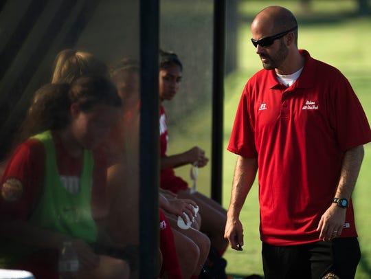 Montgomery Academy coach Stuart Bonner speaks to players