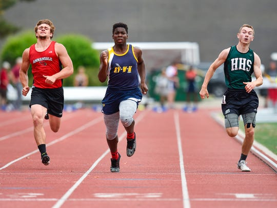 Annandale's Reed Rasset, Eden Valley-Watkins/Kimball's Donnie Johnson and Holdingford's Tyson Patrick race to the finish line in the prelims of the 100-meter dash in the Section 5A track and field championsips Wednesday, May 30, at St. John's University in Collegeville.