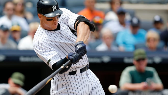 New York Yankees' Aaron Judge hits a grand slam during the third inning of a baseball game against the Oakland Athletics in New York, Sunday, May 28, 2017.