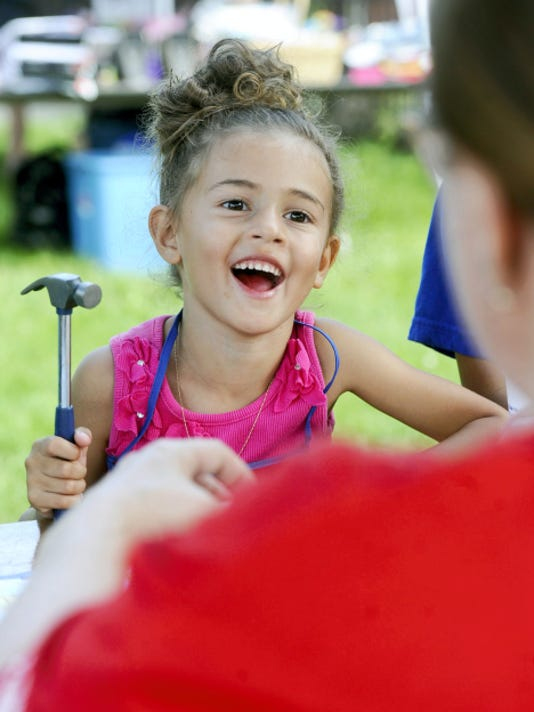 Giangely Velazquez, 4, helps build something at the Lowe's tent at the Hispanic Festival while she visits the event in York city on Saturday.