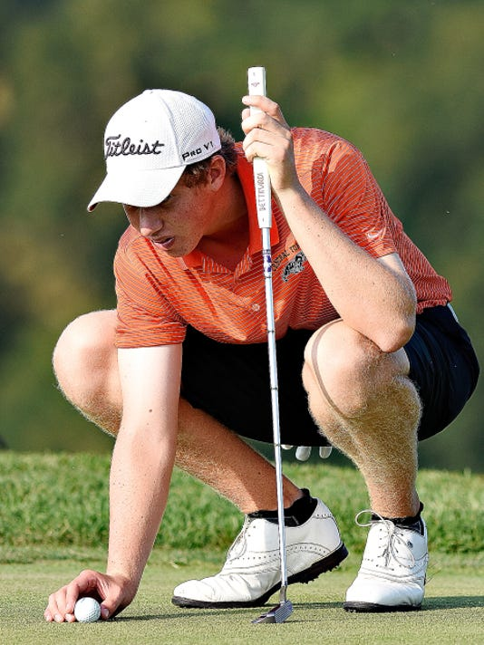 Central York's Joe Parrini, 16, lines up his putt on the 13th green during the York-Adams League Division I golf tournament at Springwood Golf Course on Thursday. Parrini fired a 70 to help the Panthers to the team win.