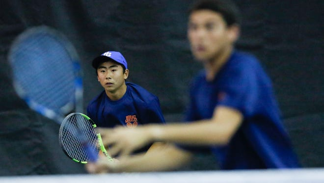 Horace Greeley's Kent Tongo and playing partner Spencer Lowitz play a point during a doubles match in the Section 1 boys tennis finals at Sound Shore Indoor Tennis Center in Port Chester on Thursday, May 25, 2017.