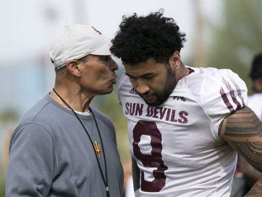 ASU head football coach Herm Edwards talks to ASU linebacker