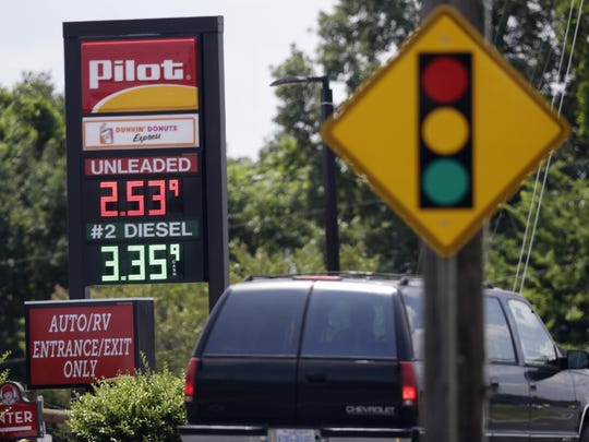 Slowly entering traffic and easing into stops can help delay the need to fill up.