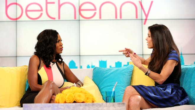 Bethenny Frankel, right, hosts Omarosa on her talk show.