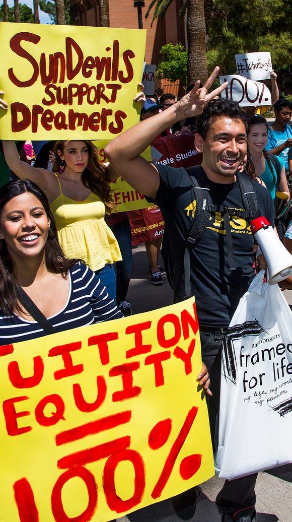 Korina Iribe, left, a DACA recipient, and Jesus Cisneros,