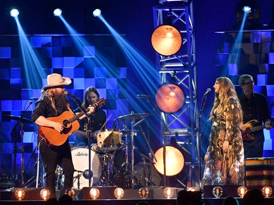 Chris Stapleton performs with his wife, Morgane, during the CMA Awards on Nov. 8, 2017, at Bridgestone Arena in Nashville.