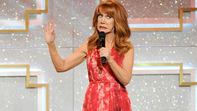 In this June 22, 2014 file photo, host Kathy Griffin speaks on stage at the 41st annual Daytime Emmy Awards at the Beverly Hilton Hotel, in Beverly Hills, Calif. There has been no progress in adding women or minorities to the ranks of late-night network talk shows since Joan Rivers held the job on Fox 30 years ago. Griffin, a close friend of Rivers, said women don't get a fair chance at network late-night host jobs.
