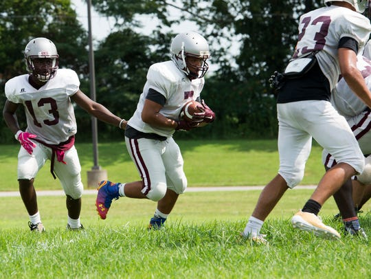 A West Creek player charges with the ball during his