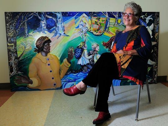 """""""I want this to be a place where we collect the heroes,"""" says Bernice Davidson, an art professor at Martin Methodist College. """"We will change it from what everybody thinks of Pulaski."""" Davidson is working on her ninth mural as part of her Heroes Project."""
