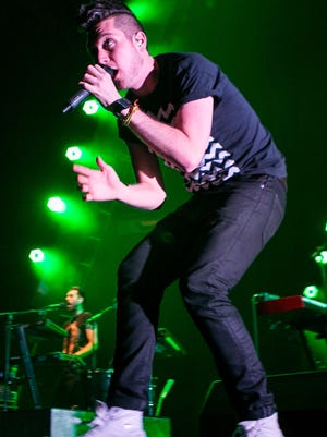 Dan Smith of Bastille performs live at Key Arena on Nov. 25, 2014, in Seattle.