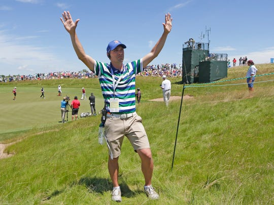 Nate Dosch, signals with his arms for the crowd to be silent during the first round Thursday of the U.S. Open at Erin Hills.