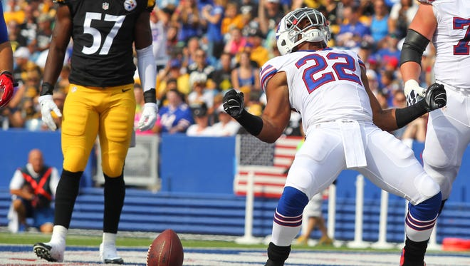 Buffalo Bills running back Fred Jackson (22) celebrates his touchdown in front of Pittsburgh Steelers inside linebacker Terence Garvin (57) during the first half of a preseason NFL football game on Saturday, Aug. 29, 2015, in Orchard Park, N.Y.