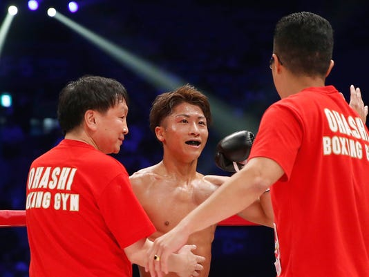 Japanese champion Naoya Inoue celebrates after knocking out challenger Ricardo Rodriguez of the U.S. in the third round of their WBO super flyweight boxing world title match in Tokyo, Sunday, May 21, 2017. Inoue defeated Rodriguez in the round to defend his title. (AP Photo/Toru Takahashi)