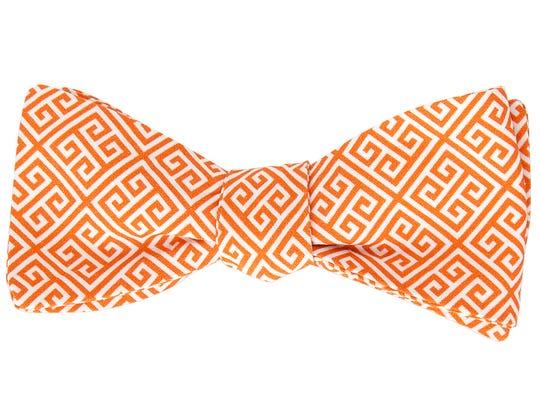 Greek Key printed cotton bow tie in orange.
