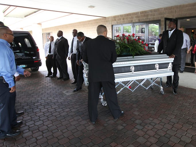 The casket of Jimmy Ellis is taken from the sanctuary of Canaan Christian Church and put into the hearse. May 12, 2014