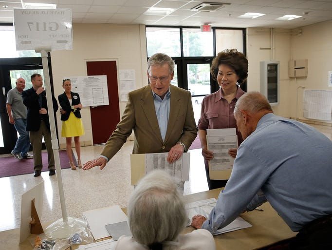 Senate Minority Leader Mitch McConnell votes in Kentucky's Republican primary with his wife, Elaine Chao, on May 20, 2014, at Bellarmine University in Louisville.