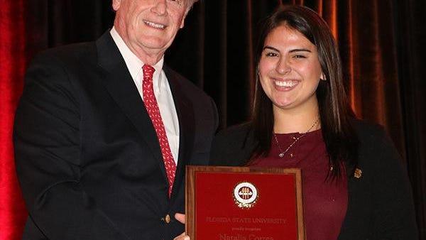 FSU President John Thrasher and AmeriCorps Member Volunteer, Natalia Correa