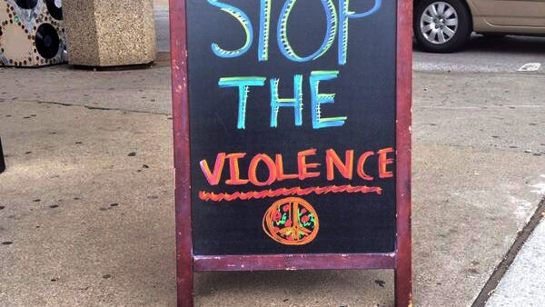 A sign outside Greek's Pizzeria in Broad Ripple on Sunday.