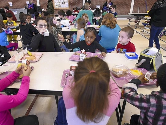 Students gather in the gym for lunchtime at the Winooski