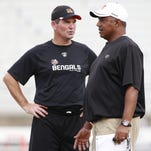 Former Cincinnati Bengals defensive coordinator Mike Zimmer, left, will bring his Minnesota Vikings in for joint training camp practices with Marvin Lewis and the Bengals.