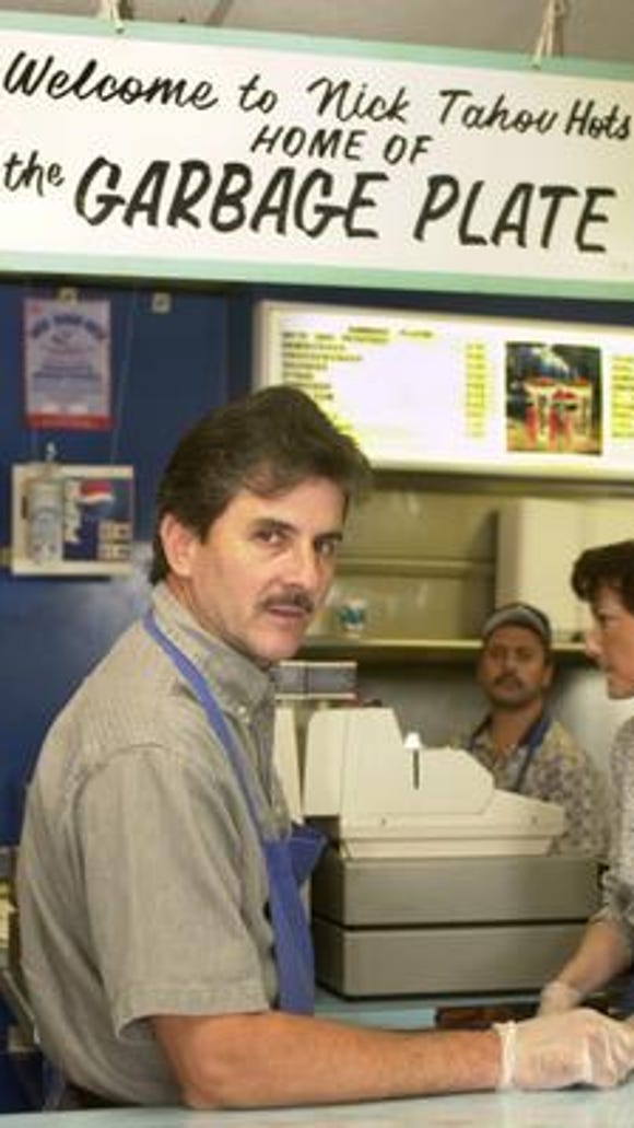 Owner Alex Tahou from a 2000 file photo at Nick Tahou Hots, the home of the Garbage Plate.