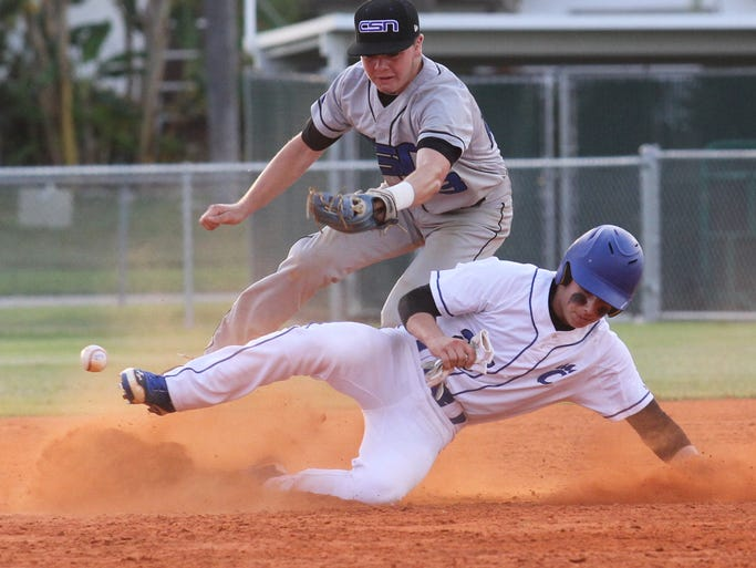 Canterbury's Michael Matter slides safely into 2nd base as he knocks the ball out of the glove of CSN's Jack Smith during the Region 2A-3 quarterfinals at Rutenberg Park on Wednesday.