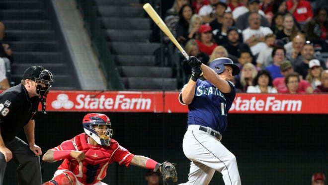 Seattle Mariners' Kyle Seager connects on a three-run home run as Los Angeles Angels catcher Martin Maldonado watches in the eighth inning of Saturday's game.