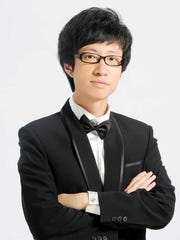 """Jiang Xie leads the PMF Orchestra in Borodin's Overture to """"Prince Igor"""" in the Aug. 21 concert as part of PMF's Emerging Conductor program."""