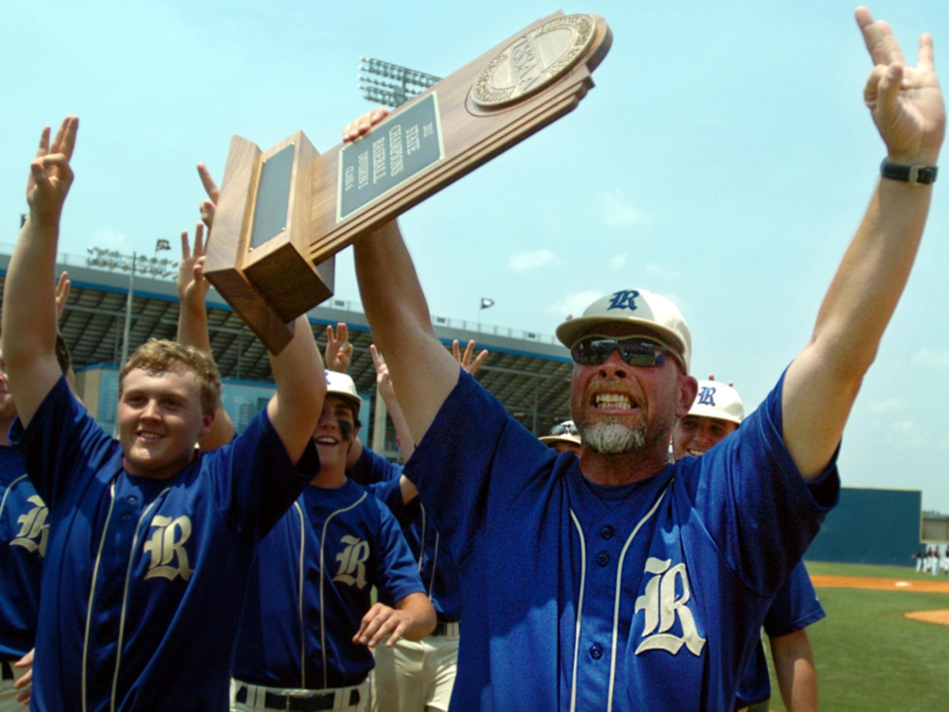 Former Riverside head baseball coach Dusty Rhodes celebrates after leading the Panthers to their third straight state championship in 2012. Rhodes has been hired as an assistant coach at Hardin County.