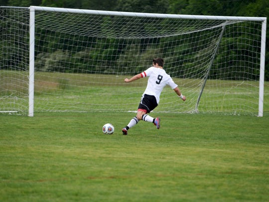 Lexington's Jace Vestal shoots on an open goal against South Gibson in the Region 7 A-AA semifinals.